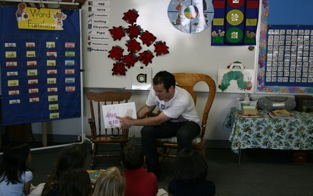 Senior, David Nolan, reads to a group of students