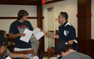 Coach Gamboa Assists New Player With Paperwork